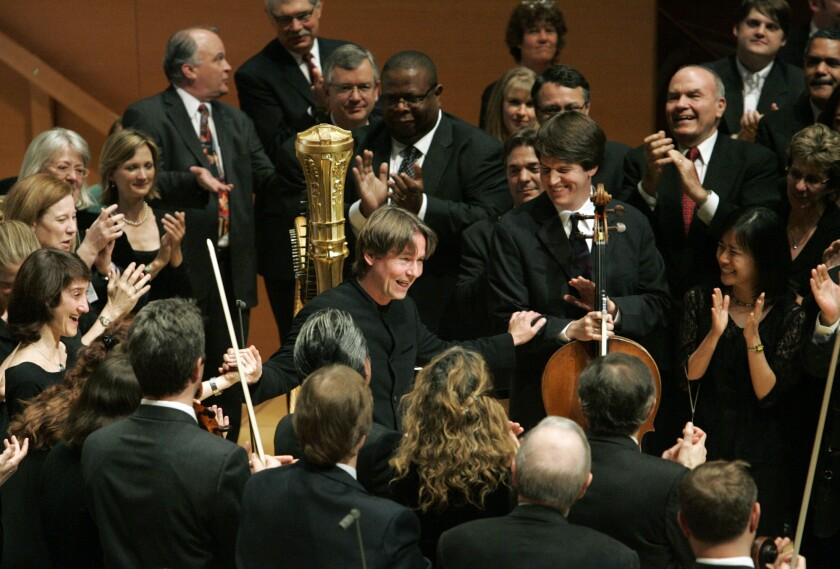 After his last concert as music director of the Los Angeles Philharmonic, Esa-Pekka Salonen is surrounded by his musicians on the stage of Walt Disney Concert Hall.