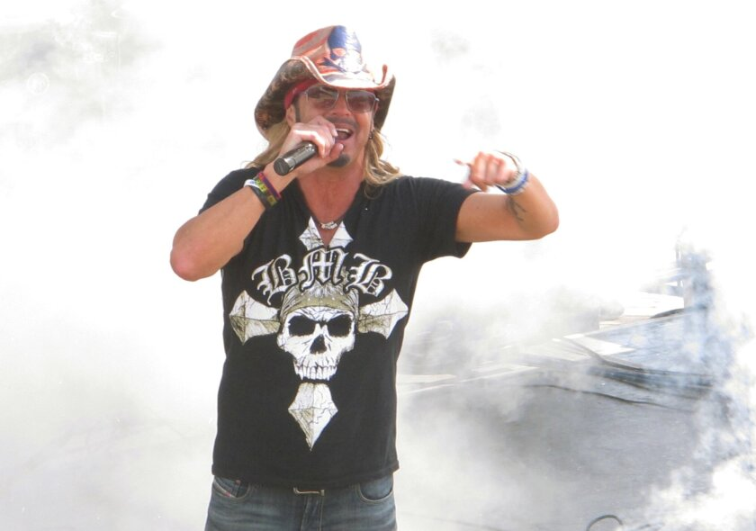 Bret Michaels performs at a free concert on the Seaside Heights, N.J. boardwalk on Friday May 27, 2016, one of many events around the Jersey shore to mark the unofficial start of summer. (AP Photo/Wayne Parry)
