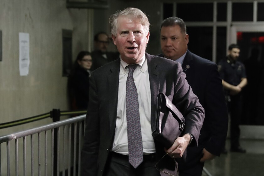 Cyrus Vance Jr. leaves court carrying a satchel.