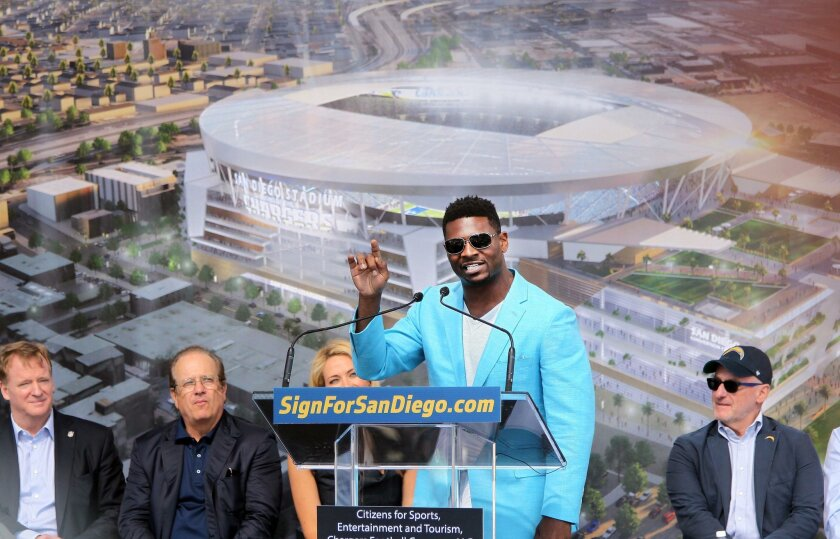 Former Chargers running back LaDanian Tomlinson speaks to Chargers fans and supporters of a new stadium near NFL Commissioner Roger Goodell, left, Chargers owner Dean Spanos and at right, Fred Maas, special advisor to Chargers' Dean Spanos.