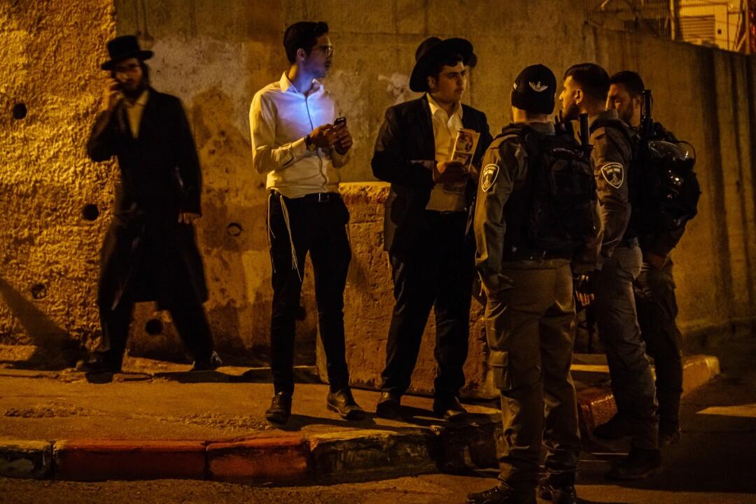 Israeli security officers escort nonresidents out of the Sheikh Jarrah neighborhood of East Jerusalem