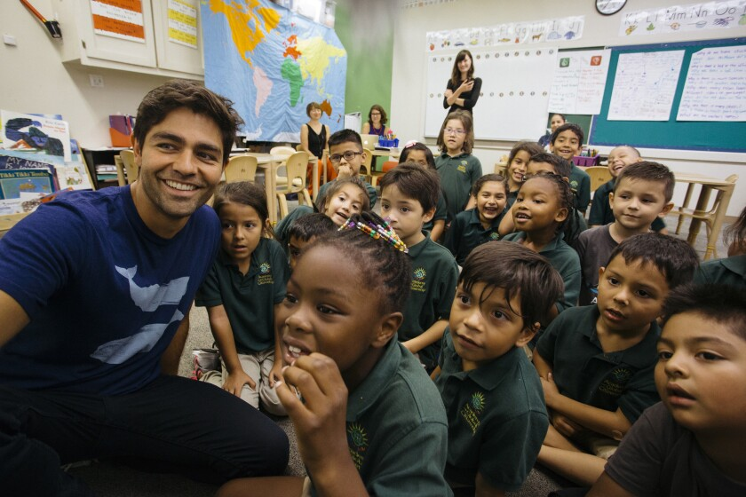 Adrian Grenier with first-graders at the Academy for Global Citizenship in Chicago. The school is the Lonely Whale Foundation's partner in its marine science education initiative.