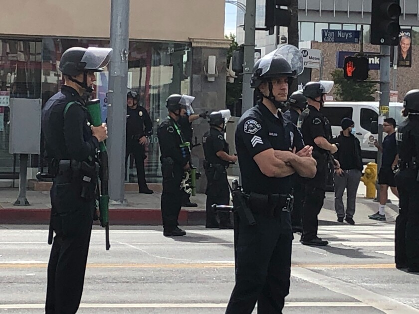 LAPD officers watch a peaceful protest June 1 on Van Nuys Boulevard.
