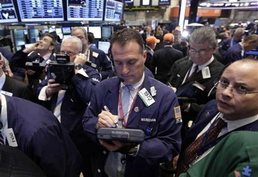 In this Thursday, May 2, 2013, photo, traders gather at a post on the floor of the New York Stock Exchange. Stock markets edged higher on Friday May 3, 2013 ahead of the release of the U.S. government's monthly unemployment report, a key measure of the health of the world's largest economy. (AP Photo/Richard Drew)