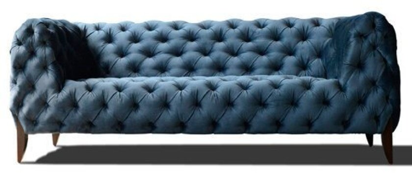 Designer Nathan Anthony's 'Sabine sofa' in midnight blue is among the many contemporary-design furnishings available from At-Home. (Courtesy Photo)