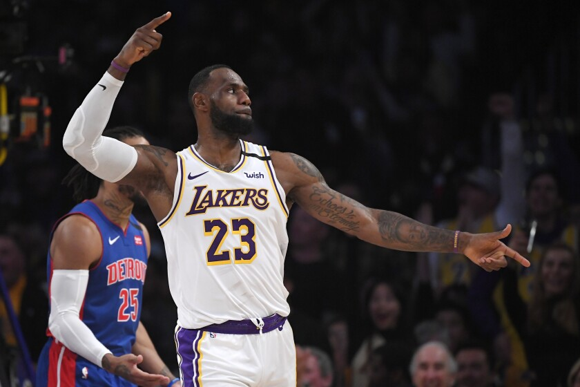 LeBron James celebrates after a Lakers score against the Detroit Pistons at Staples Center.