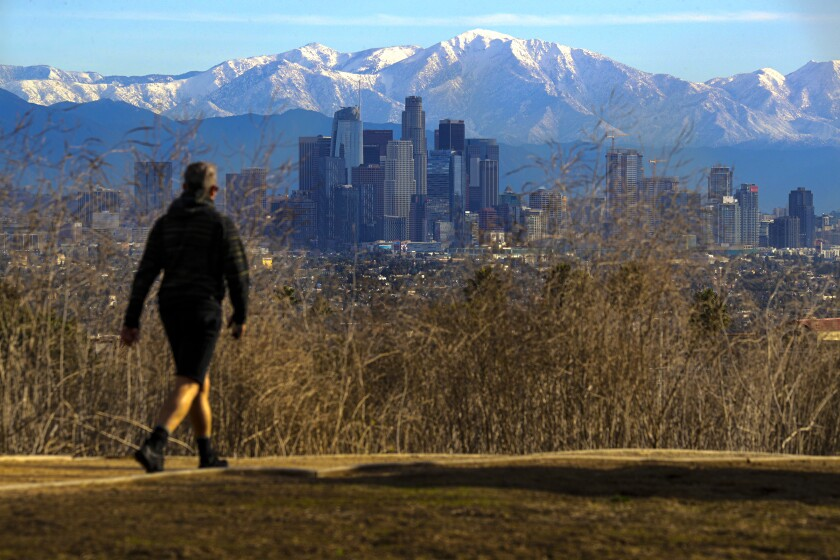 The downtown Los Angeles skyline is seen from Kenneth Hahn State Recreation Area against the backdrop of snow-covered mountains in this Nov. 30 photo.
