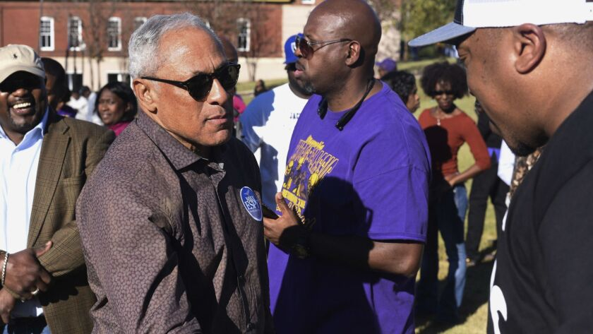 Mike Espy, who is seeking to unseat appointed U.S. Sen. Cindy Hyde-Smith, R-Miss., shakes hands with