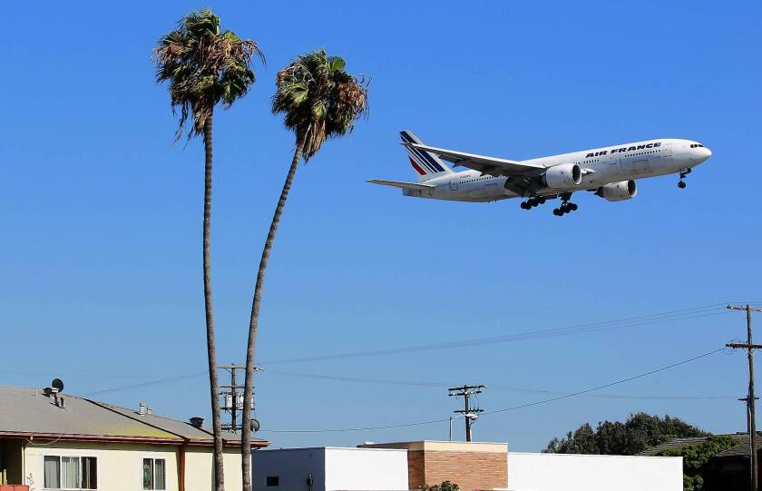 A plane heads toward one of the northern runways at LAX. A coalition of business and labor groups wants to increase the distance between the facility's two northern runways to more easily accommodate the largest commercial airliners, such as the giant Airbus A380. Neighborhood groups, however, say the project would degrade surrounding residential and commercial areas.