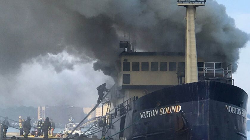 Firefighters respond to the blaze on the Norton Sound docked north of Seaport Village in 2017.