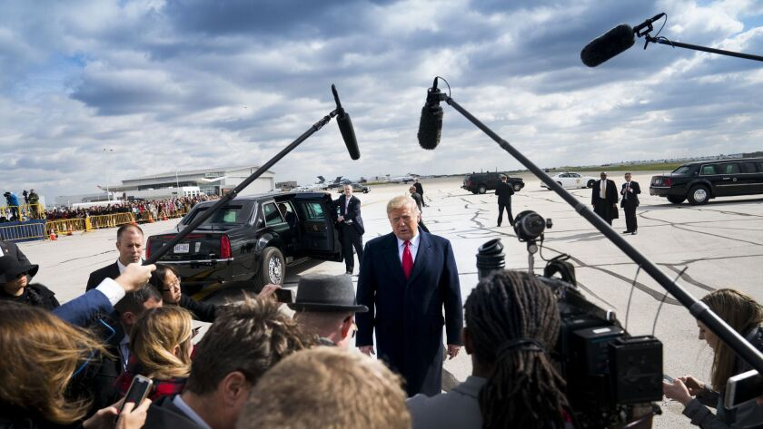 President Donald Trump speaks to reporters in Indianapolis.