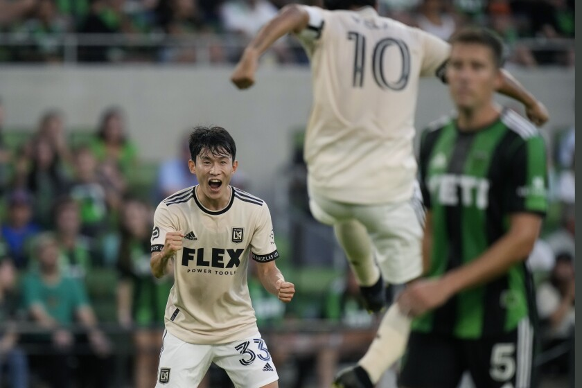 Los Angeles FC defender Kim Moon-Hwan (33) celebrates a score with teammates during an MLS soccer match against Austin FC, Wednesday, July 7, 2021, in Austin, Texas. (AP Photo/Eric Gay)