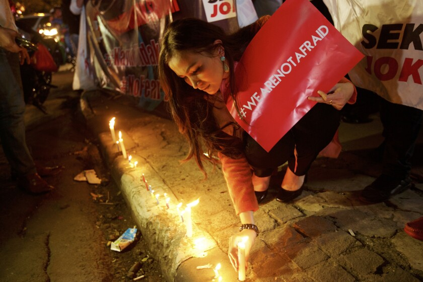 Lighting candles in Jakarta, Indonesia.