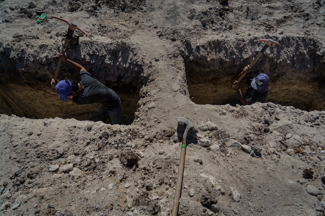 Cemetery workers dig additional graves at Tijuana's Municipal Cemetery No. 13.