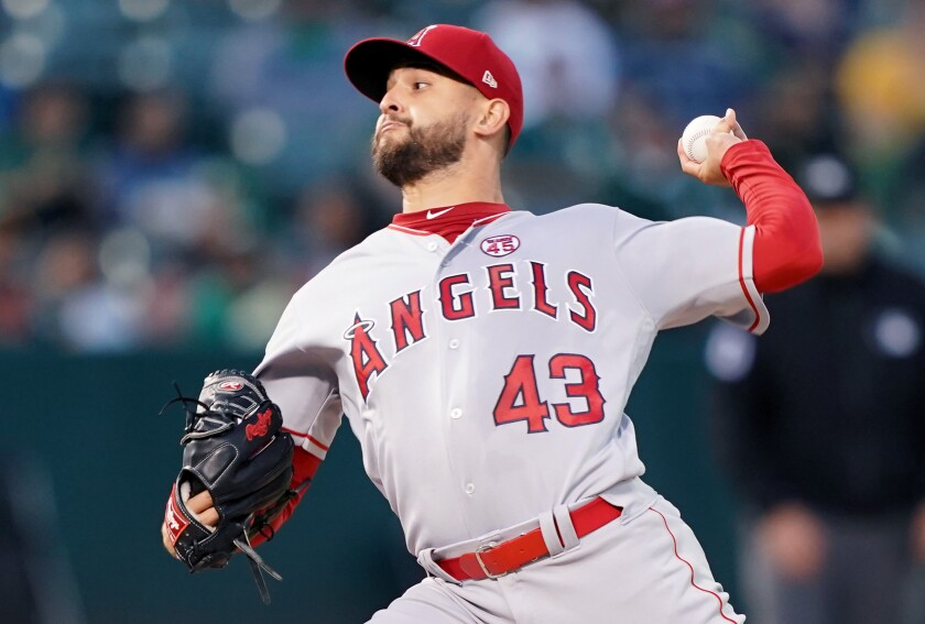 Angels pitcher Patrick Sandoval pitches against the Oakland Athletics in the bottom of the first on Wednesday in Oakland.