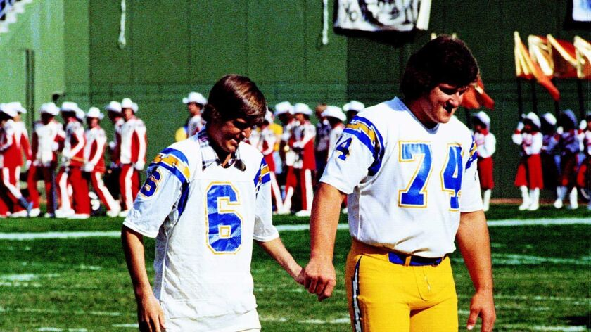 Chargers kicker Rolf Benirschke, who had been hospitalized, joins Louie Kelcher (74) to participate in the coin toss before the Chargers-Steelers game on Nov. 19, 1979.