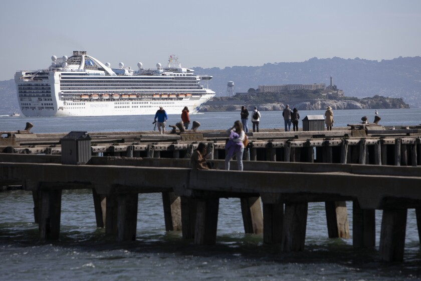 Grand Princess cruise ship sails past Alcatraz Island as it prepares to dock in Oakland