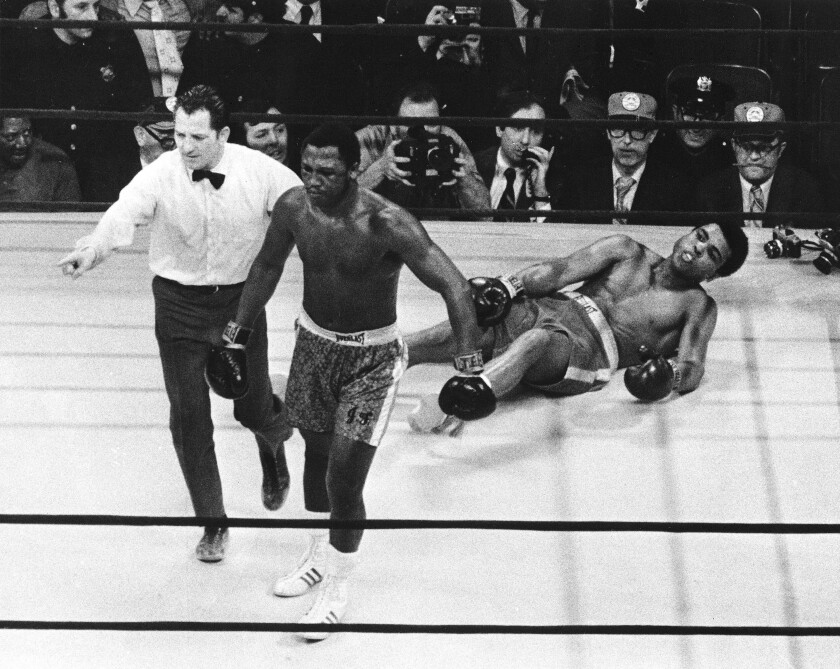 Joe Frazier is directed to his corner by referee Arthur Mercante after knocking down Muhammad Ali.
