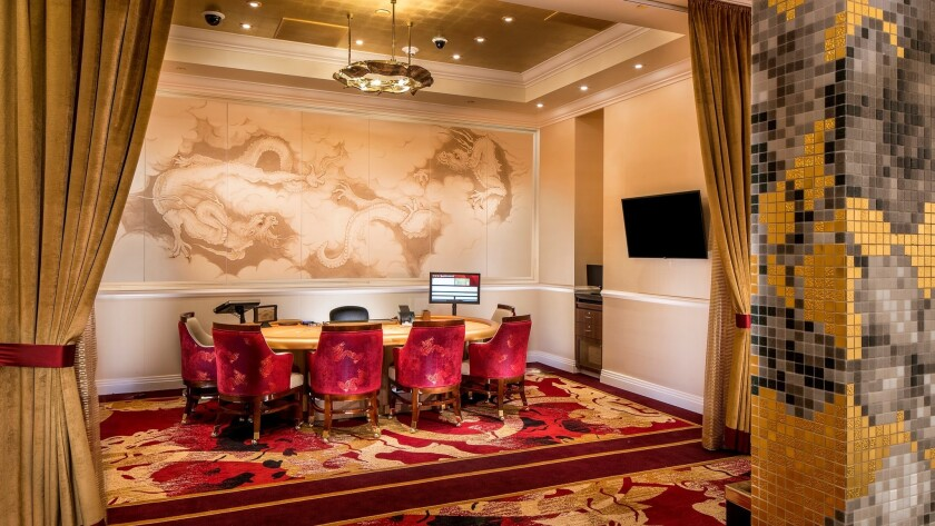 High rollers can play baccarat while enjoying a catered meal in the exclusive VIP gambling area at Lucky Dragon Hotel & Casino.