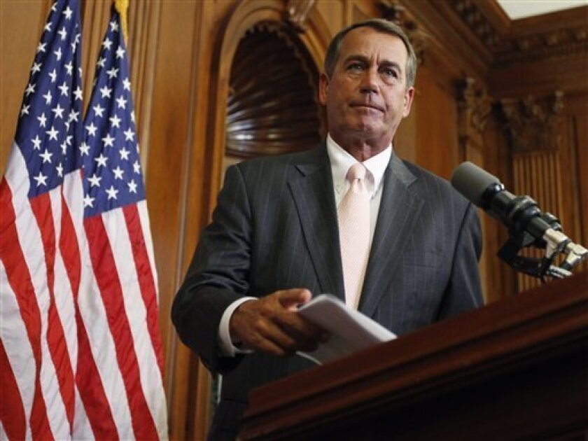 FILE - In this June 16, 2010 file photo, House Minority John Boehner, R-Ohio, participates in a ceremony on Capitol Hill in Washington. Boehner could walk down most U.S. streets anonymously. But the perpetually tanned golf lover, who grew up in a Cincinnati family of 14, could become the next House speaker and the GOP leader of opposition to President Barack Obama. (AP Photo/Carolyn Kaster, File)