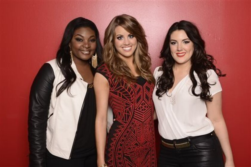 """This May 2, 2013 photo released by Fox shows, from left, Candice Glover, Angie Miller and Kree Harrison, finalists in the singing competition series """"American Idol,"""" in Los Angeles. (AP Photo/Fox, Michael Becker)"""