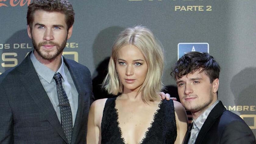 Liam Hemsworth, left, Jennifer Lawrence and Josh Hutcherson in Madrid.