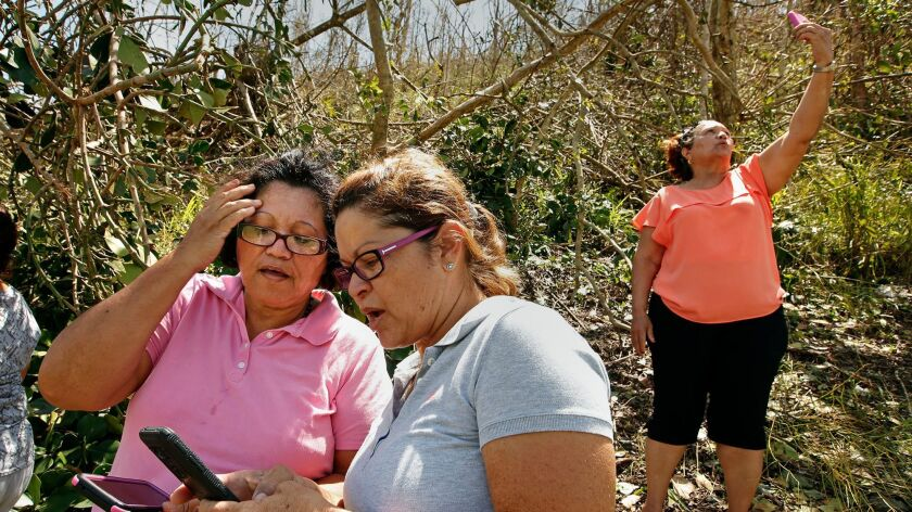 People to try to find a cellphone signal to notify family members they are OK.