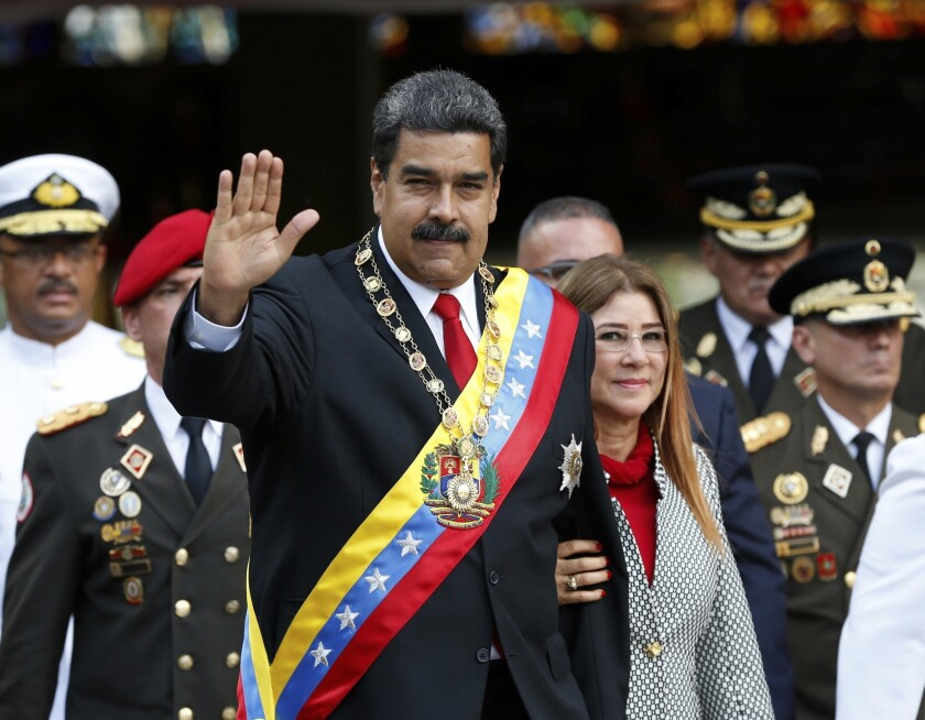 Two firefighters are behind bars for mocking Venezuela's President Nicolas Maduro by comparing him to a donkey.