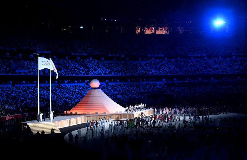 Entertainers perform during opening ceremony at the Tokyo Olympics.