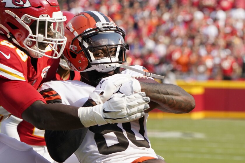 Cleveland Browns wide receiver Jarvis Landry, right, scores past Kansas City Chiefs defensive tackle Tershawn Wharton during the first half of an NFL football game Sunday, Sept. 12, 2021, in Kansas City, Mo. (AP Photo/Ed Zurga)