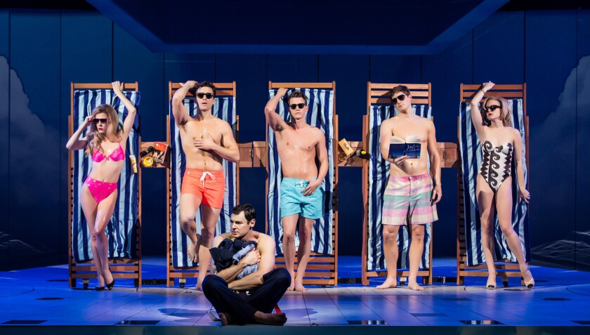 """Benjamin Walker, seated, center, in a scene from the play """"American Psycho."""""""