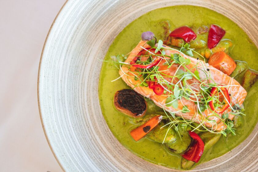 The spectacular pan roasted salmon in spicy green curry broth is one of the $40 dinner menu choices at Island Prime during Restaurant Week.