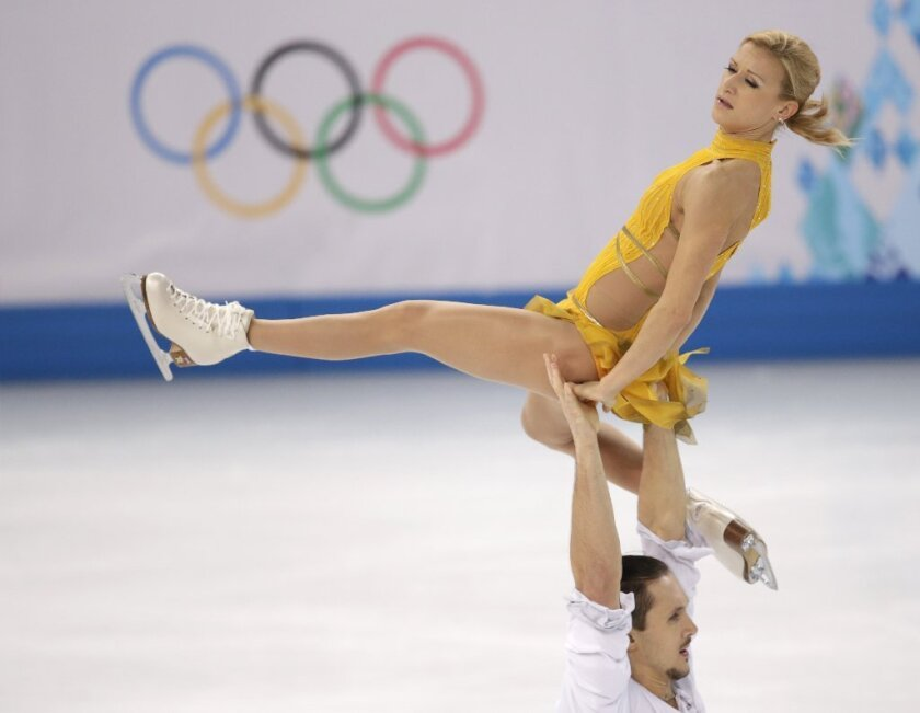 Tatiana Volosozhar and Maxim Trankov of Russia compete in the pairs free skate competition at the 2014 Winter Olympics in Sochi, Russia.