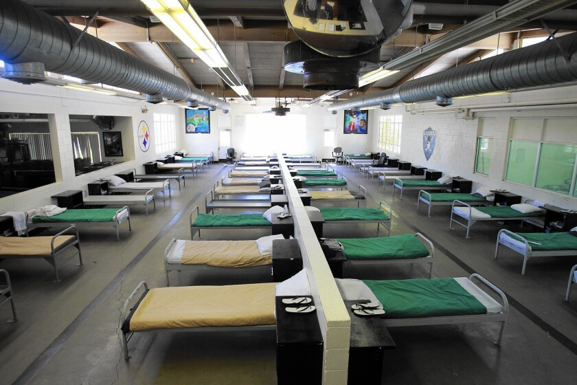 Beds line a dorm at now-closed Camp Miller, a Los Angeles County juvenile probation camp in Malibu. Campus Kilpatrick was built to be less punitive and more therapeutic.