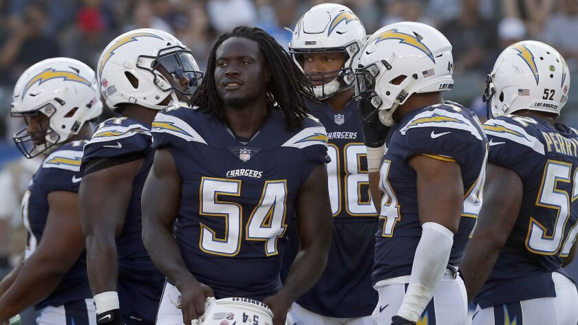 CARSON, CALIF. - AUG. 25, 2018. Chargers defensive end Melvin Ingram III (54) takes the field for a