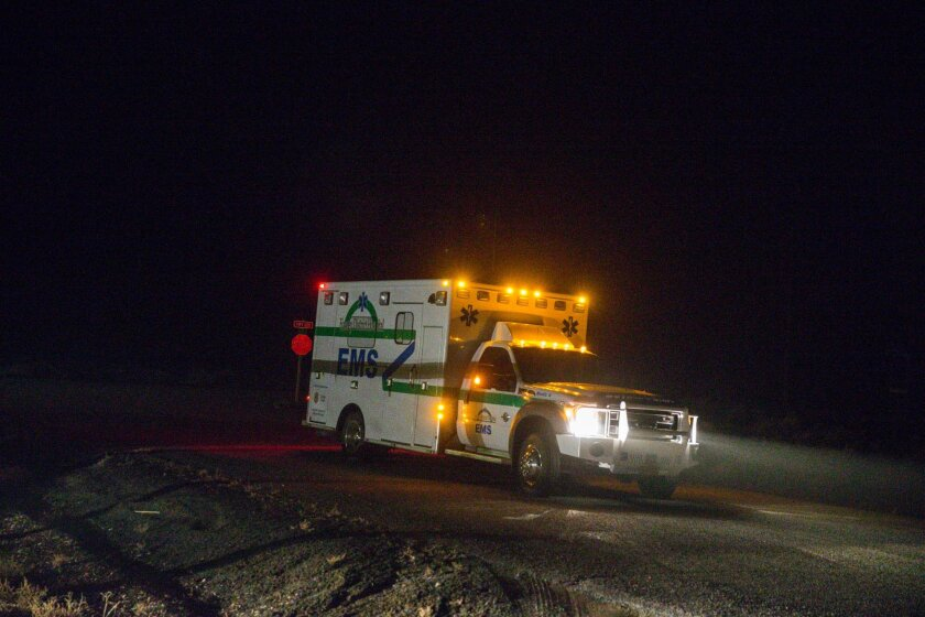 An ambulance proceeds through the Narrows roadblock near Burns, Ore., as FBI agents have surrounded the remaining four occupiers at the Malheur National Wildlife Refuge, on Wednesday, Feb.10, 2016. The four are the last remnants of an armed group that seized the Malheur National Wildlife Refuge on