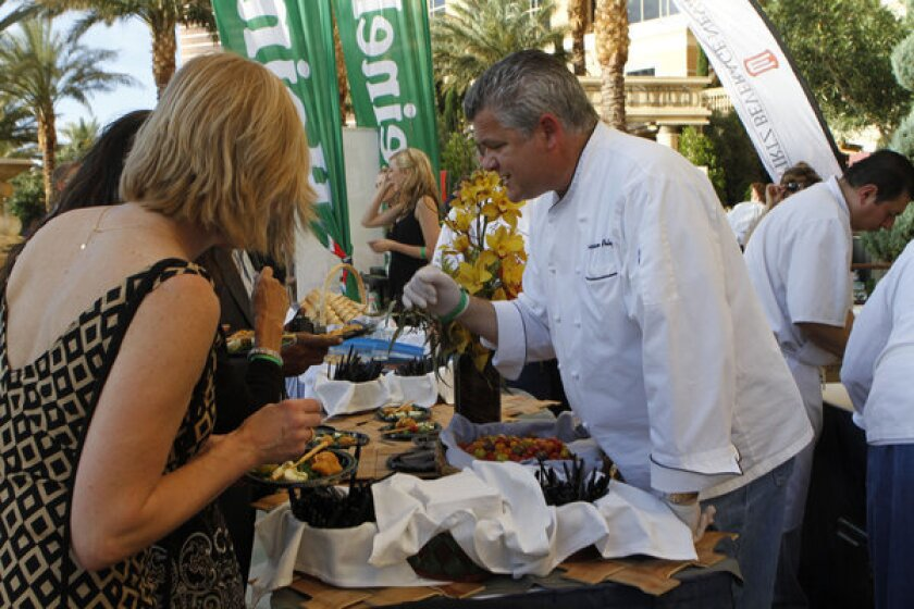 Chef Luciano Pelligrino of Valentino shares his love of cooking with guests at the 2012 Epicurean Affair.