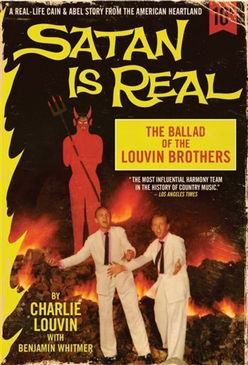 """In this book cover image released by It Books, """"Satan is Real: The Ballad of the Louvin Brothers,"""" by Charlie Louvin with Benjamin Whitmer, is shown. (AP Photo/It Books)"""