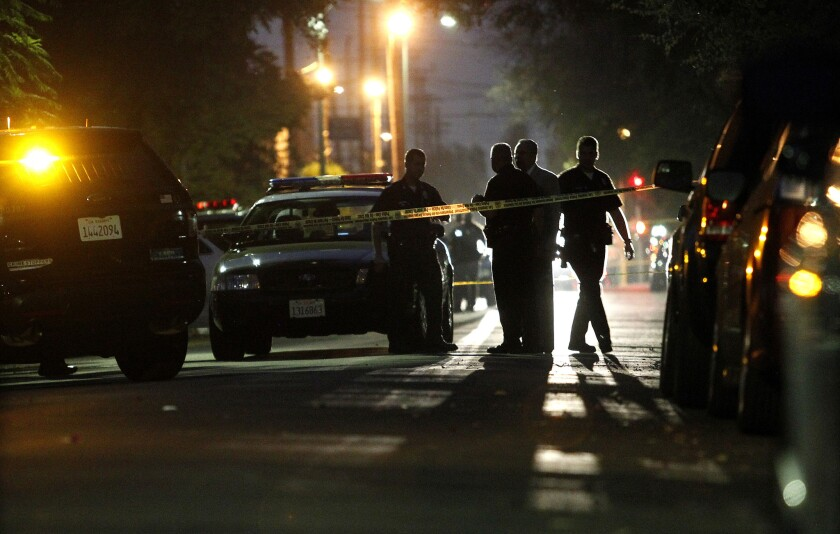 Los Angeles police investigate a shooting Tuesday evening near USC's campu.