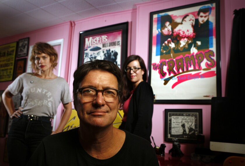 Larry Hardy, the founder of Los Angeles label In the Red, is photographed with his label manager, the artist Denee Petracek, left, and wife Robyn Ginsburg, inside his home offices.