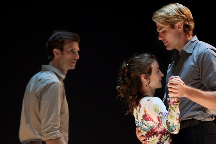 "Eddie (Frederick Weller) looks on as Catherine (Catherine Combs) is held by Rodolpho (Dave Register) during Ivo van Hove's production of Arthur Miller's ""A View From the Bridge"" at the Ahmanson Theatre."