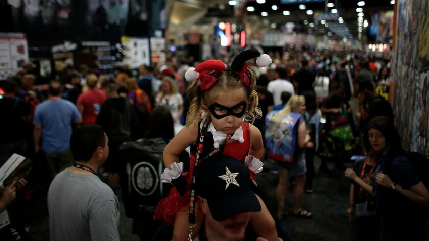 SAN DIEGO, CA, WEDNESDAY, JULY 20, 2016 -Olivia Hare, 3, as Harley Quinn, rides her father Alex's sh