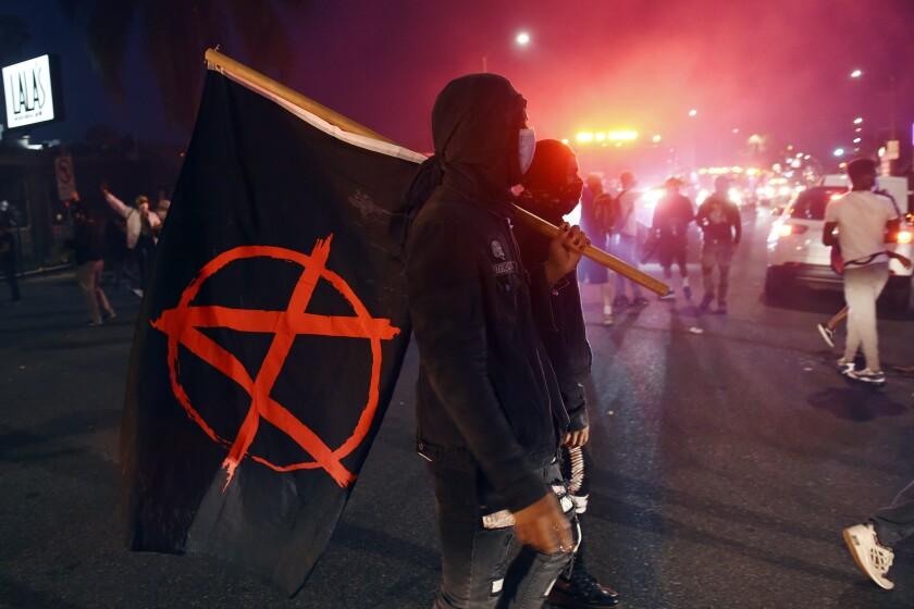 George Floyd protests: Trump blames 'antifa' for violence - The San Diego  Union-Tribune