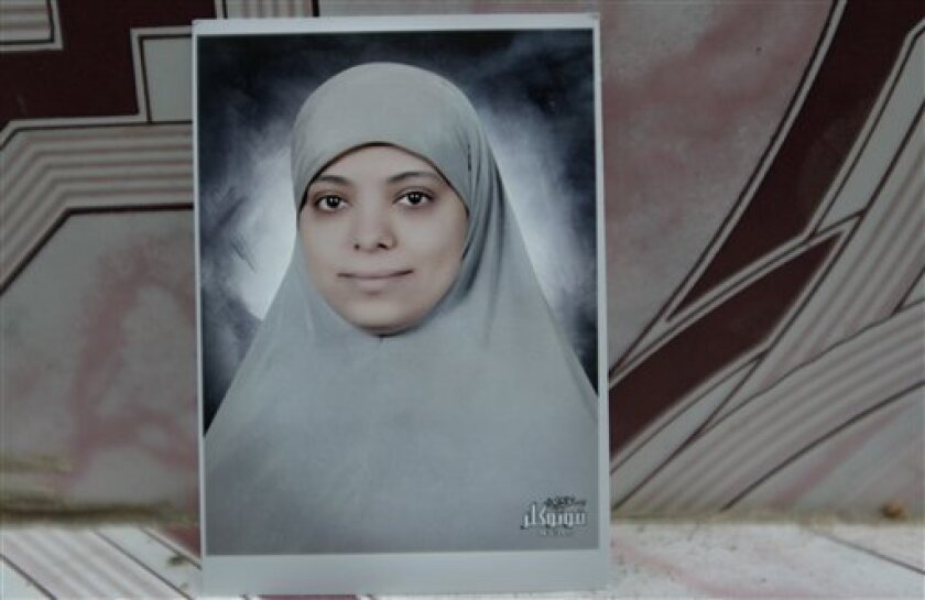In this June 23, 2011 photo, an undated passport photo of late Mariam Hawas is seen at the family house in Talkha, Mansoura, Egypt.  Hawans lost her life trying to collect her monthly salary.  Egyptians have long complained that the cheapest thing in this country is their lives.   Under the former