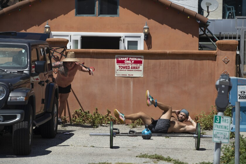 Ty and Randy Renner do a circuit training workout outside their house