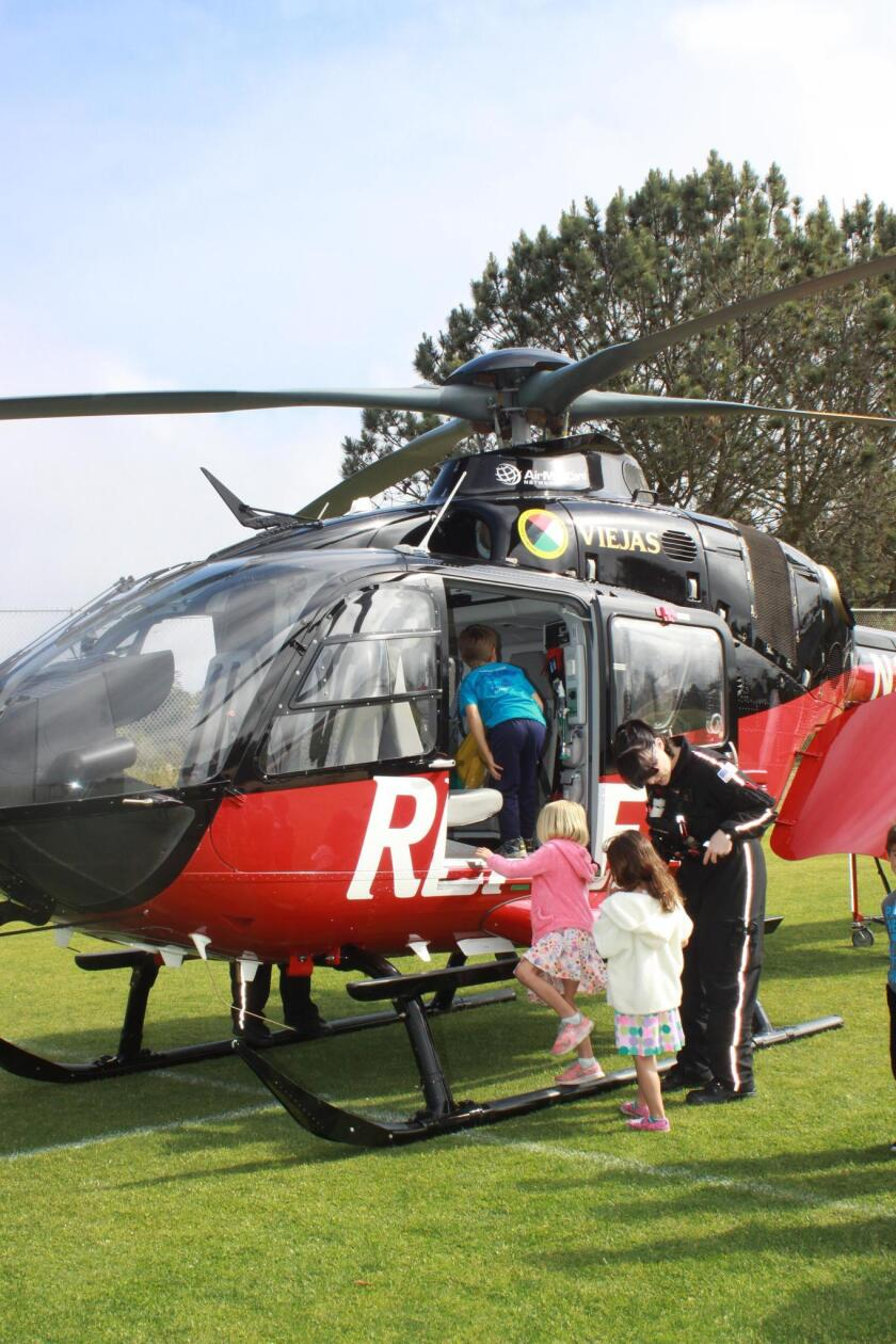Students get to see the inside of the helicopter that landed on campus for Science Discovery Day.