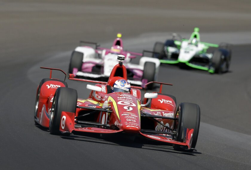 Scott Dixon, of New Zealand, drives through turn one during the final practice session for the Indianapolis 500 auto race at Indianapolis Motor Speedway in Indianapolis, Friday, May 27, 2016. (AP Photo/Michael Conroy)