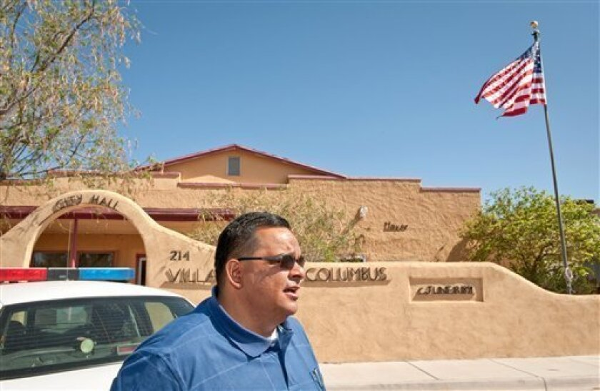 In this April 21, 2009 photo, new Police Chief Angelo Vega talks in front of the city hall in Columbus, N.M. The police department in the little border town has been in disarray, plagued with unqualified officers and allegations of wrongdoing. One chief was arrested on gun theft charges that were later dropped, and two others were never certified police officers. (AP Photo/Bill Faulkner)