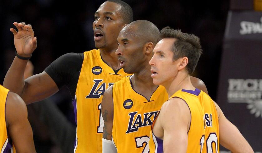 Dwight Howard, Kobe Bryant, Steve Nash look on during a game.