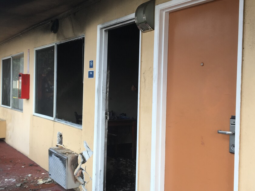 A man suffered smoke inhalation Monday morning after his motel room in El Cajon caught on fire.